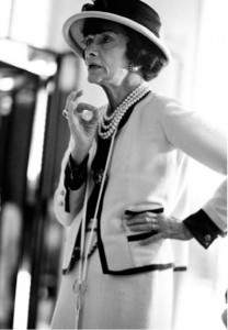 "Coco Chanel in the ""Chanel Suit"" (IMG: Wonderland Magazine)"