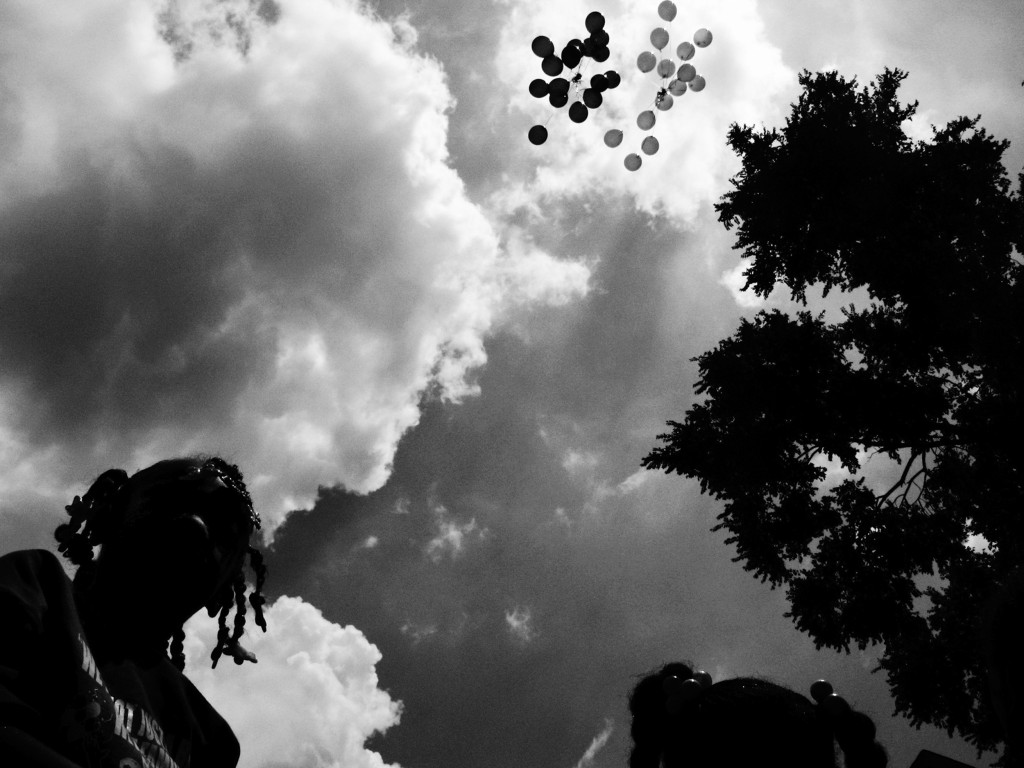 Balloons are released in memory of Siretha White and Starkeisha Reed during a block party on South Marshfield Avenue and West 69th Street. The girls were killed days apart in March 2006. Englewood, Chicago, 2009.