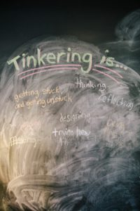 "A chalkboard in the Tinkering Lab collects ideas of what ""tinkering"" can be."