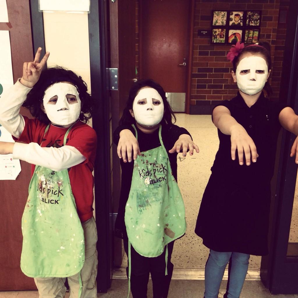 Elementary Students Beginning Their Plaster Masks