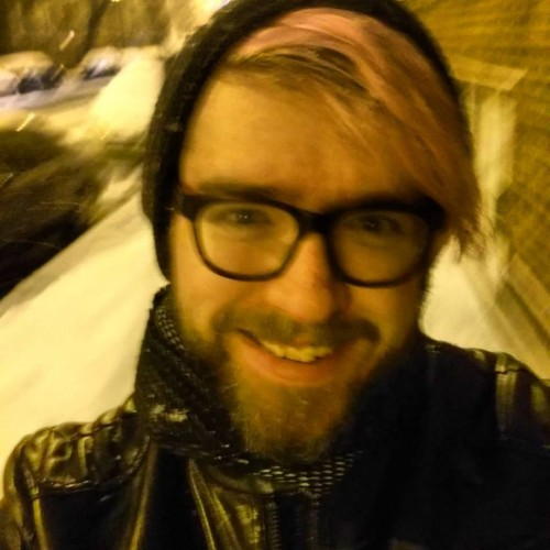 Braving the cold to acquire groceries and enjoy the snowfall while inadequately wearing a scarf (Photo by David Fairbanks)