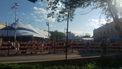 I stepped out my door to see a pile of barricades, tents, and German music for Maifest.