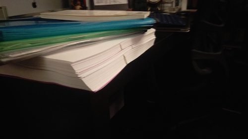 A pile of poems and papers I should probably be working on while I write this blog post