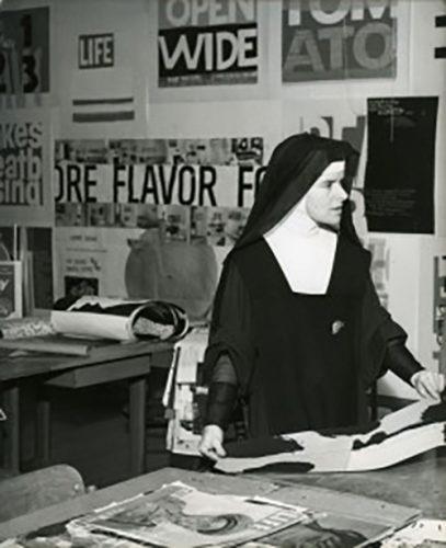 Image of Corita Kent in her studio.