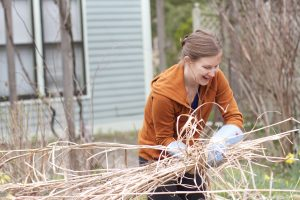Eula Biss tending the garden of poet Robyn Schiff (Photo credit: John Bresland)