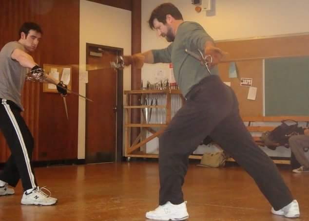 John McFarland (right) teaching swordplay to a student