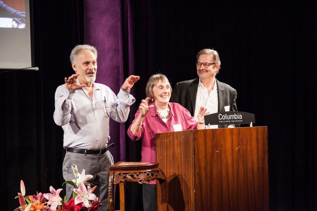 Columbia College Theatre Department faculty members Jeff Ginsberg, Caroline Latta, and David Puszkiewicz lead the auction of letters of the signage for the newly dedicated Sheldon Patinkin Theatre.