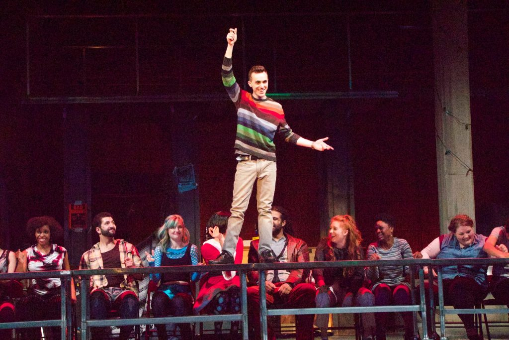 "Dominic Rescigno (center) in ""Rent."""