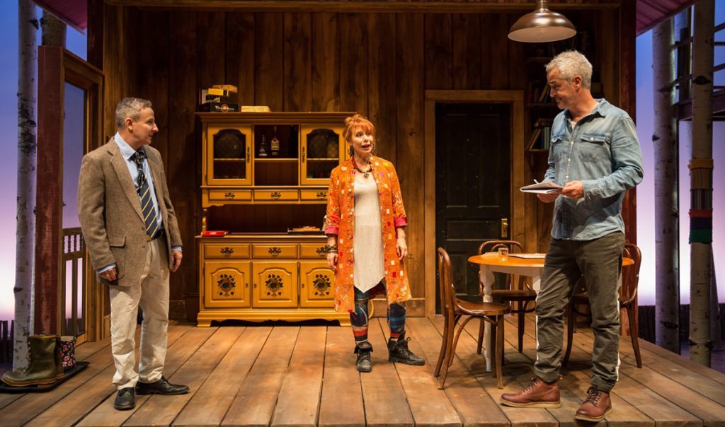 "Barbara E. Robertson (center) in ""Life Sucks"" at Lookingglass Theatre."