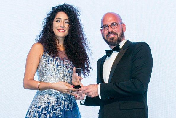 "Dana Dajani (left) receiving ""Emirates Woman"" magazine's ""Woman of the Year 2016"" Award."