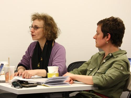 Professors Mimi Schaer and Mel Potter give feedback.